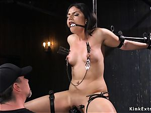 dark-haired submitted with head in a cage