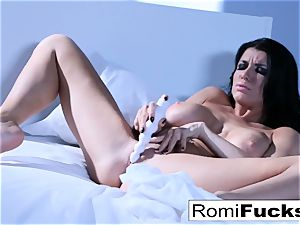 Solo fun on the bed with the huge-chested superstar Romi Rain