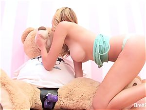 Brett Rossi plays with a jammed bear's strap-on faux-cock