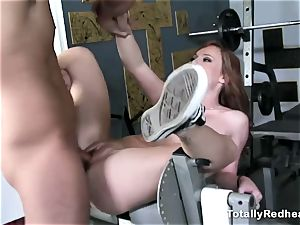 red haired silly gets penetrated stiff in the gym