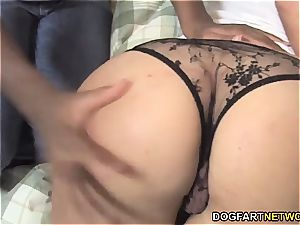 Candice Nicole punishes Kelly Wells' ass with strap dildo