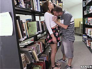 Joseline Kelly plumbing in the library