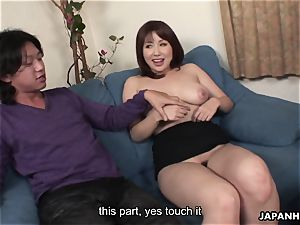 japanese cock deep-throater has a pair of lollipops to suck on