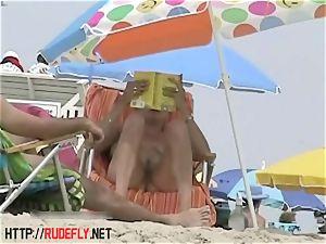 Candid naked beach nubile rump voyeur