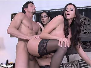 Mature fellow Tommy Gunn pokes his wife and a youthful bespectacled daughter-in-law